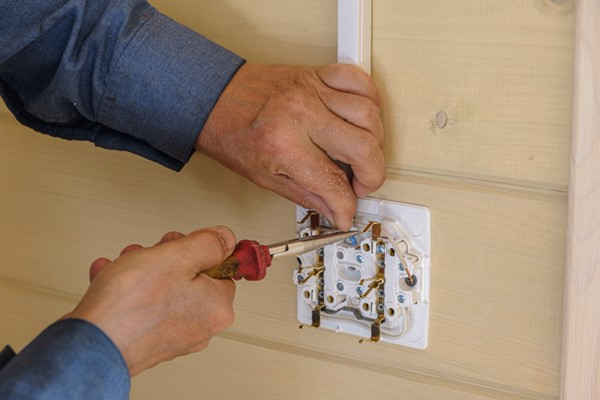 Electrical Engineer Installs Electric Outlet